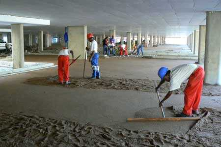 group of Sun Paving workers working on a commercial parking area project