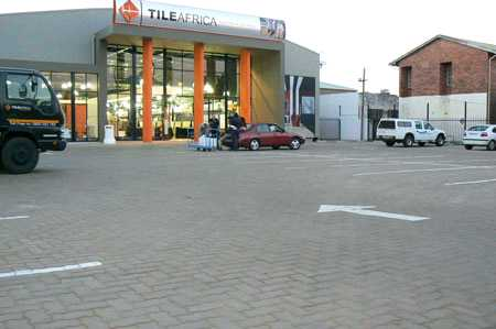 paved parking lot outside a shopping mall done by sun paving