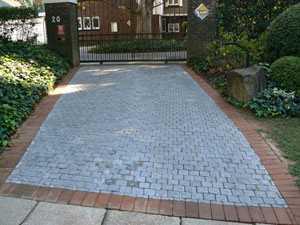 a driveway brick paved near the gate entrance don by sun paving