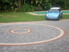 car parked near paved patio area done by sun paving