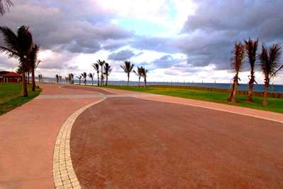 sidewalk paved near a beach area paved by sun paving